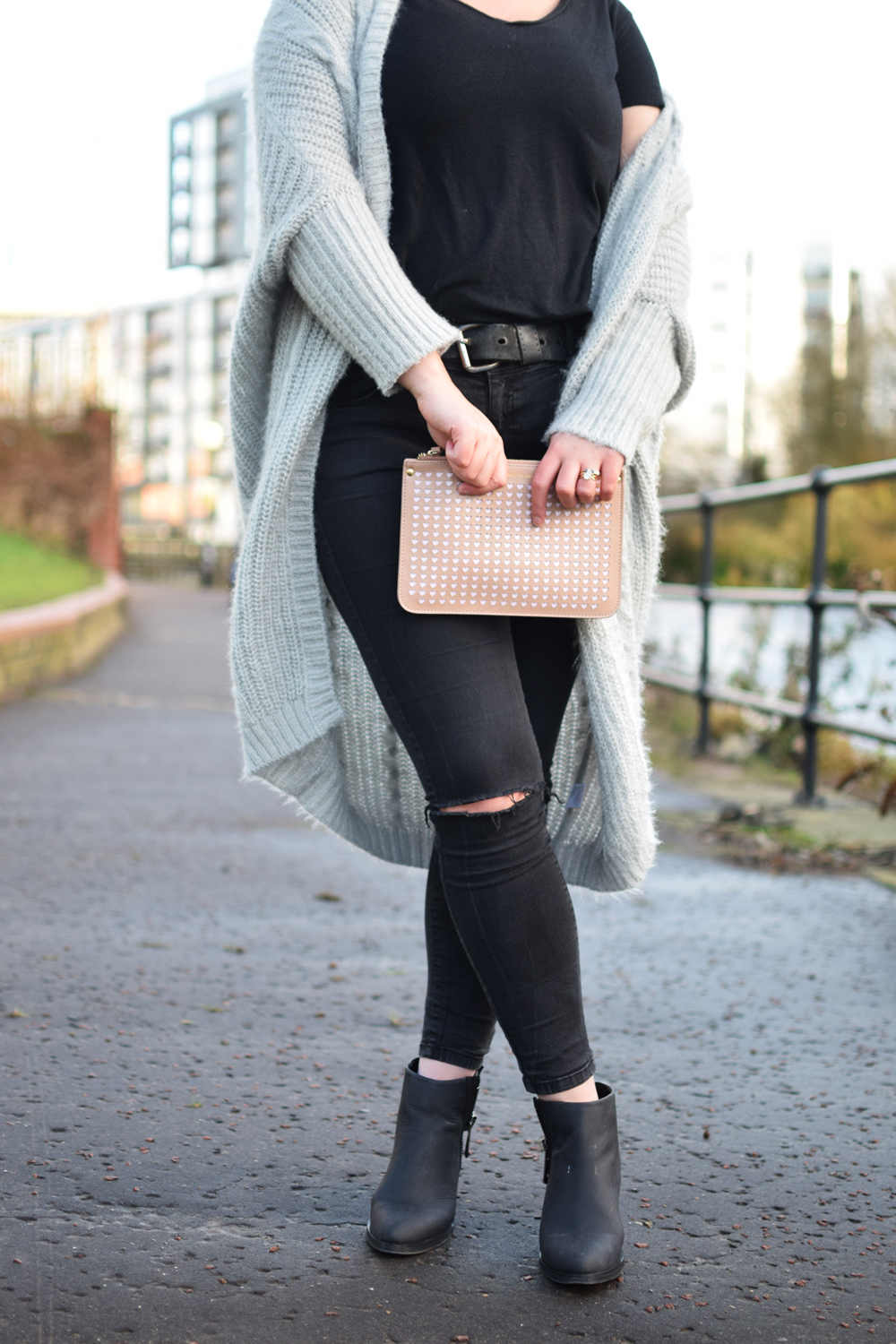 Cosy knit and pink clutch