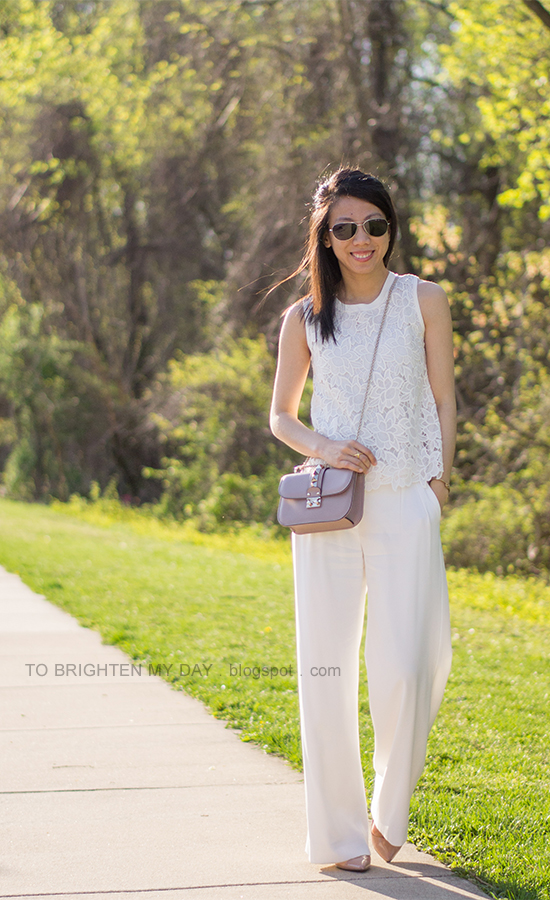 white lace sleeveless top, white trousers, nude pumps, crossbody nude studded bag
