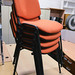 Orange vibrant stacking chairs