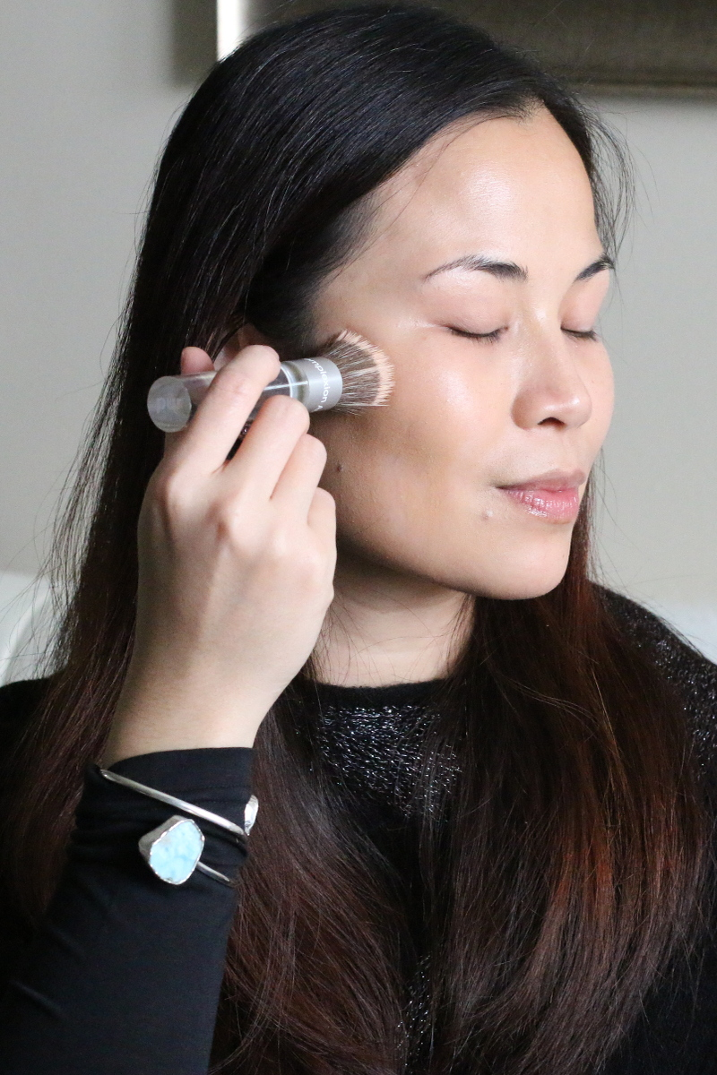 applying foundation, makeup brush