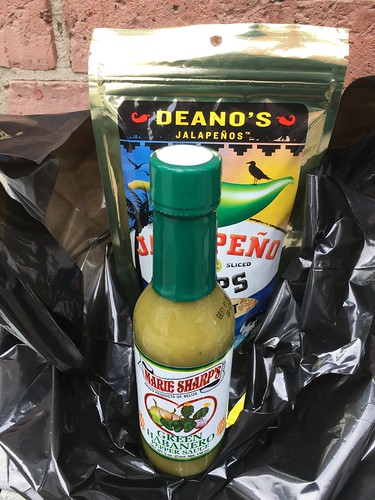 Jalapeño snacks and green habanero pepper sauce.
