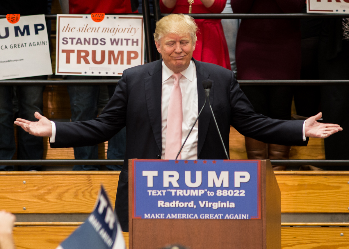 Donald Trump emphatically orates in front of the crowd.