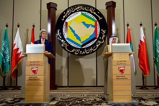 Secretary Kerry Listens as Saudi Arabian Foreign Minister al-Jubeir Addresses Reporters After a Gulf Cooperation Council Ministerial Meeting in Manama