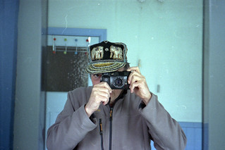 reflected self-portrait with Yashica Auto Focus camera and elephant hat