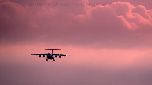 morning pink silhouette clouds plane airplane dawn morninglight swiss aircraft aviation jet arrival approach bae sr airliner bru avro jetliner 146 jumbolino swr ebbr regionaljet swissairlines rj100 baesystems ttail avroliner