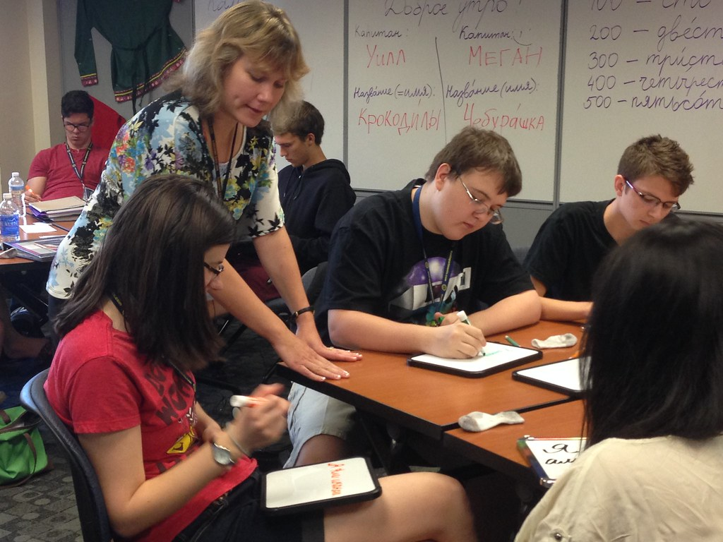 Instructor Tatyana Bystrova with Russian foreign language academy students practicing their writing on dry erase boards.