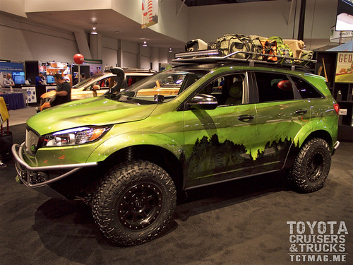 Kia showed off it's offroad concept based on the Sorrento platform. Fox Racing suspension, custom metal tube bumpers and a roof rack framed the lime green paint job.