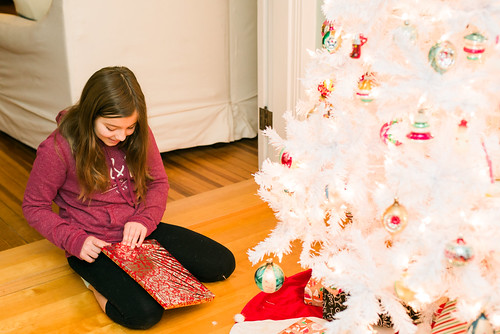 Tearing through the gifts.
