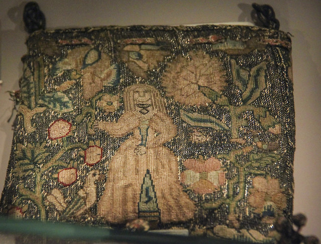 Sweet bag worked in silks on a ground of silver thread with text woven in drawstring, England, 1620-1630