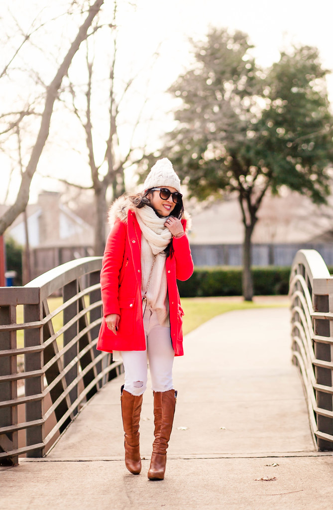 cute & little blog | petite fashion | white pom beanie, j.crew chateau fur hood parka, white infinity scarf, white knit sweater, white jeans, cognac tall boots | winter outfit