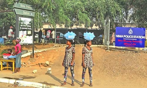 ghana accra nima police station blackwoman water pack vendor west africa african gηανα solo travel bilwander westafrica