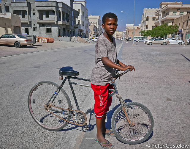 Omani boy with his bicycle