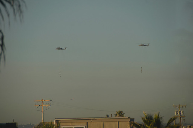navy drill people hanging from helicopers-1