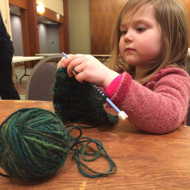 "Maddy came to Knitting Guild with me! She showed off her knitting skills to my friends, and was very patient waiting her turn for ""show and tell"" in front of the whole guild (we showed off her new sweater!) It's so neat to share these special parts of my"