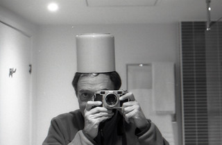 reflected self-portrait with Lordomat camera and cylindrical hat