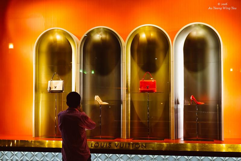 Man Looking At Ladies' Luxury Shopping