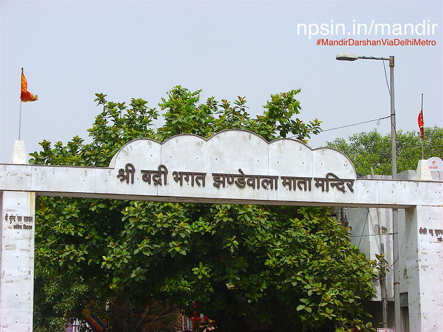 Road side entry of Jhandewalan state with welcome board and full name of temple