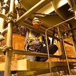 A Blue Grass Chemical Agent-Destruction Pilot Plant worker tests signals on a conveyer door in the Munitions Demilitarization Building. During operations, chemical weapons will be disassembled, explosives removed and the agent neutralized in this facility.