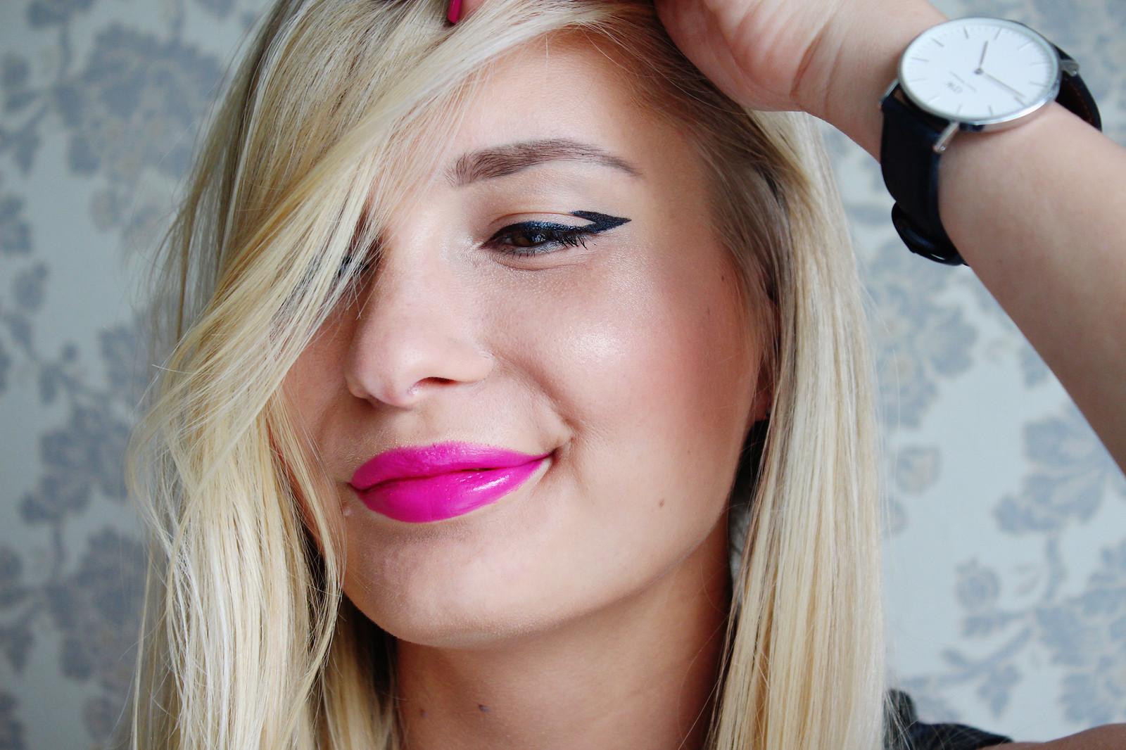 Bold pink lipstick