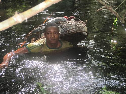 Bemba crossing a swollen river
