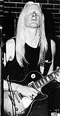 Johnny Winter playing a Sunburst Les Paul