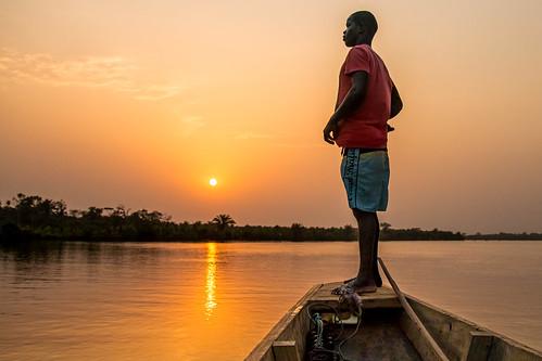 lagune soleil coucher ci nuit pirogue côtedivoire afrique aube assinie sudcomoé