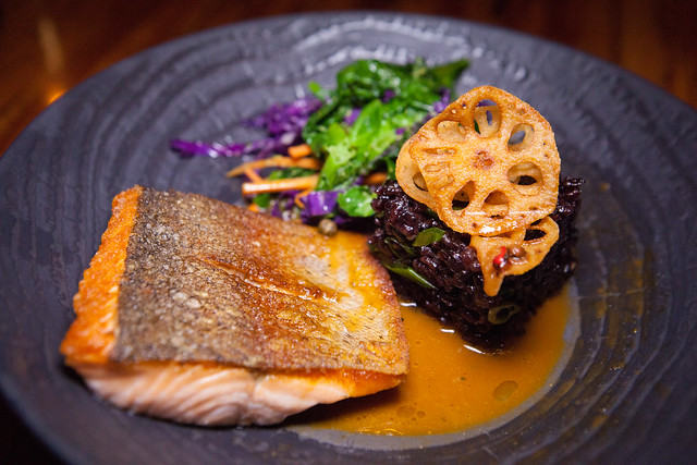 La Truite au Poivre - Steelhead Trout, Sautéed Greens, Purple Fried Rice, Lotus Root Chips, Pink Peppercorn Miso Demi