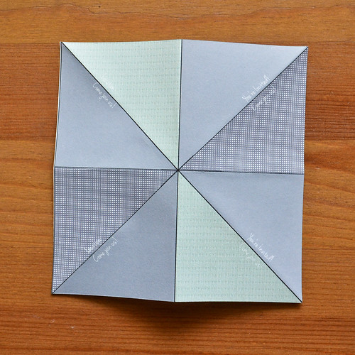 Step 6. Fold along all 4 lines (2 diagonal, 2 perpendicular)