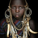 Young Mursi girl by JCH Travel