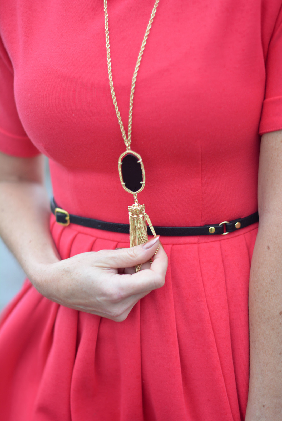 Red fit and flare dress, black and gold pendant