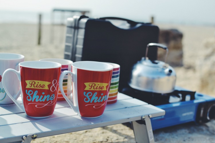 Breakfast mugs on the beach