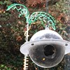 My great uncle Jim's copyrighted satellite bird feeder, forever hanging at my Dad's place. Tried to get a shot with a bird, but they are just too quick. :)