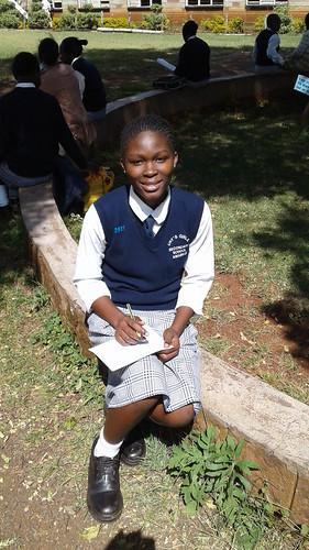 A smiling Neema in her school uniform