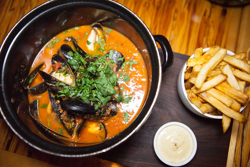 Moules Frites 'Congolaise' - Mussels, tomato coconut cream, smoked chili, lime, cilantro