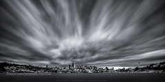 I thought it was high time for myself to step out of my own comfort zone. I do enjoy B&W photography from other artists but have always considered myself as color guy. This image is a very long exposure of the great looking skyline of Seattle. The storm c