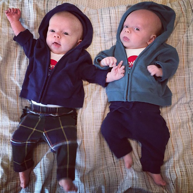 "Stepping up our game today with pants AND hoodies. (Onesies say ""twins"" on them, made by friends at our baby shower.)"