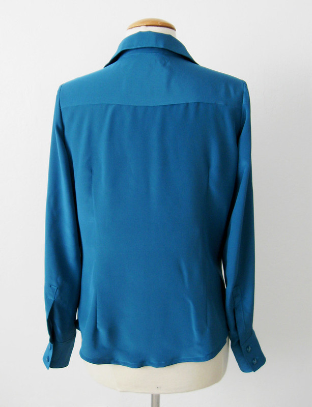 silk blouse back view on form