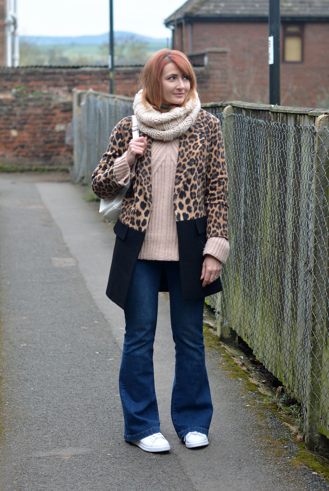 Winter style: Two tone leopard/black coat, flared jeans, white Adidas Stan Smiths | Not Dressed As Lamb
