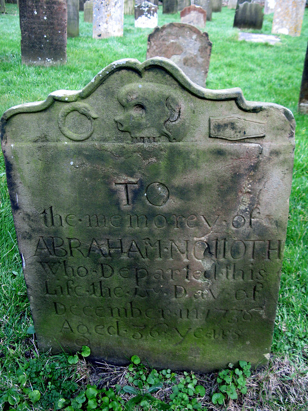 gravestone with oroborous