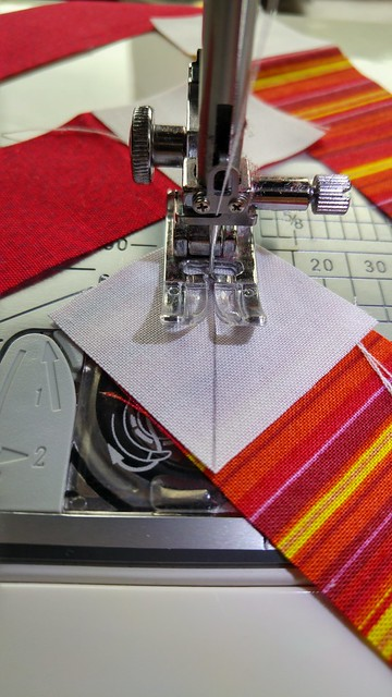 Sewing just to the outside of the centre line to compensate for the thicknesses of fabric and thread when pressing