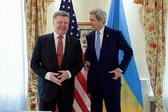 U.S. Secretary of State John Kerry shares a laugh with Ukrainian President Petro Poroshenko before a bilateral meeting on February 13, 2016, at the Bayerischer Hof Hotel in Munich, Germany, on the sidelines of the Munich Security Conference. [State Department photo/ Public Domain]
