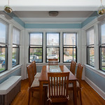Seven windows in this dining room nook means all your meals will be set with stellar views.