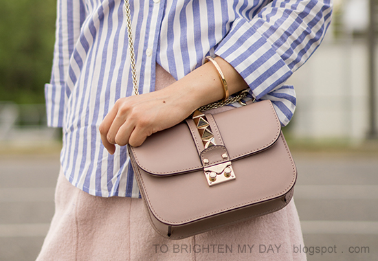 blue and white striped shirt, rose gold cuff, pink wool shift dress, nude crossbody bag