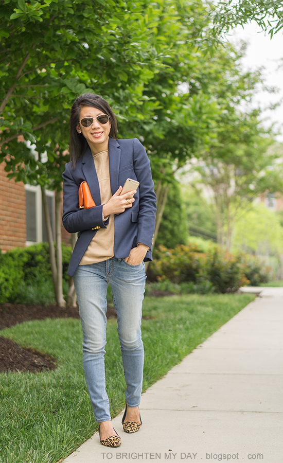 navy blazer, camel sweater tunic, lightwash distressed jeans, orange clutch, leopard flats