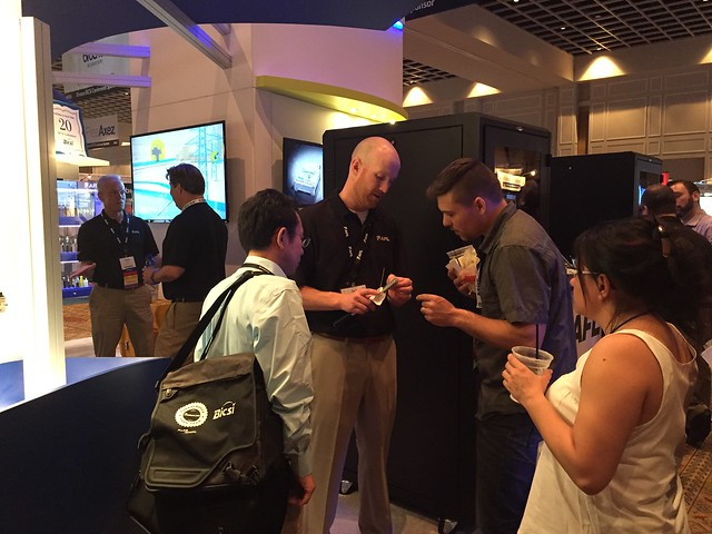 Zack showing fiber optic cable at BICSI