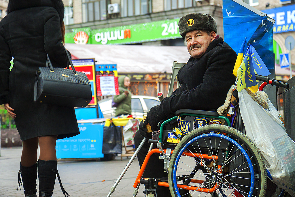 Middle-aged man in wheel chair, begging--Kiev