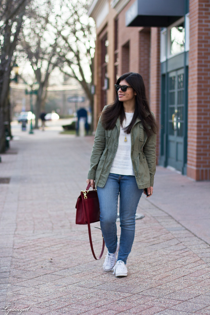 field jacket, jeans, converse sneakers, red coach bag.jpg