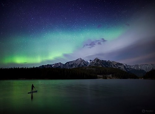 """Ferrywoman"" The amazing Sue Shih enjoys the aurora from her paddloboard a few nights ago in Banff National Park. As some of you may know Sue and I have worked together extensively over the last couple of years to try to create some SUP images that have a"