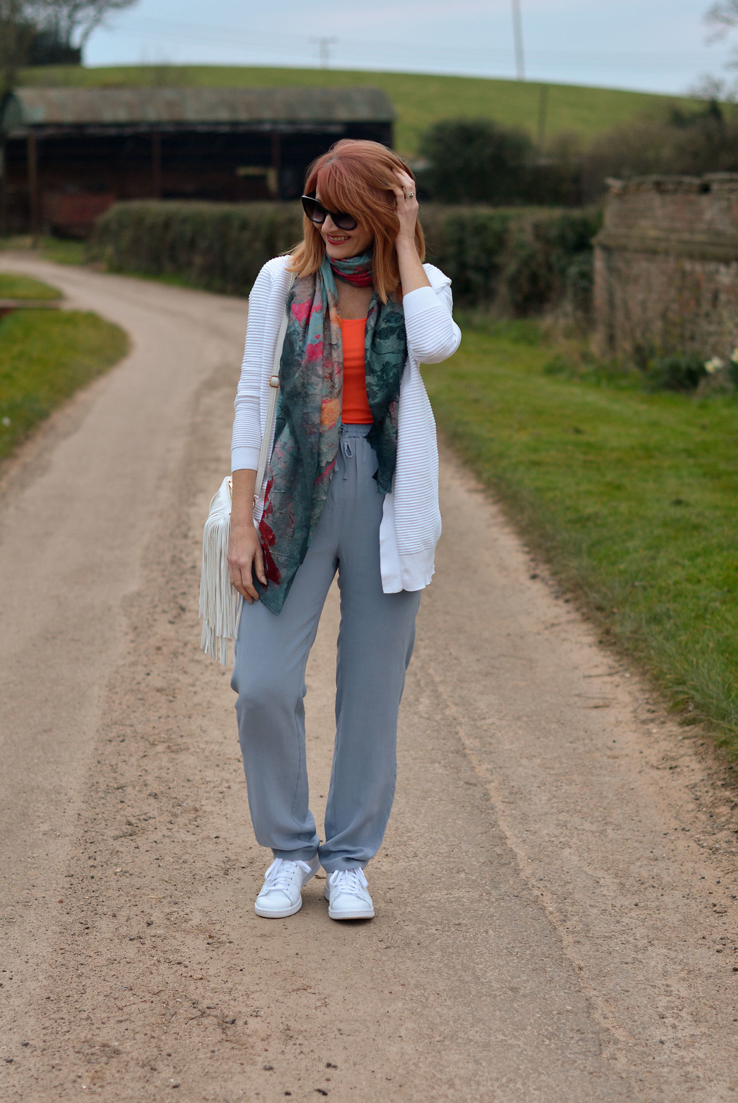 Spring Style: Loose silk pants, orange tank, neck scarf, white Adidas Stan Smiths | Not Dressed As Lamb