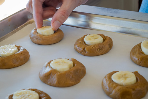 adding a banana slice to each cookie